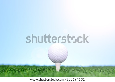 A studio photo of golfing equipment on artificial grass