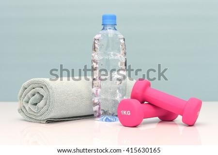 A studio photo of gym equipment - stock photo