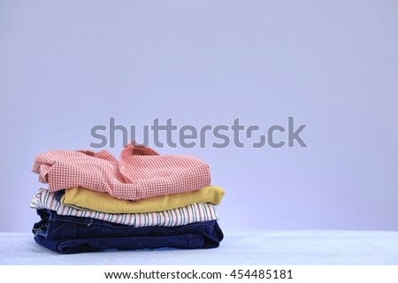 A studio photo of ironing and laundry items