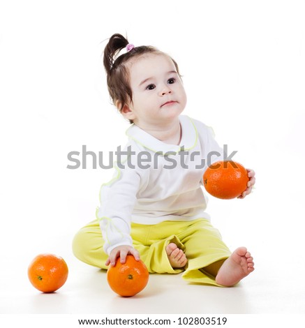 a studio portrait of a smiling little girl with apples isolated on white background - stock photo