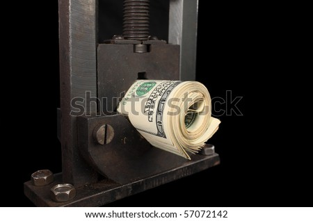 A studio shot depicting the falling value of the American dollar. - stock photo