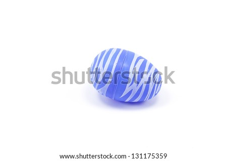 A studio shot of a blue plastic easter egg with room for copy