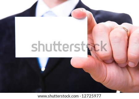 A studio shot of a businessman holding out a blank business card. Room for text, or your own message. - stock photo