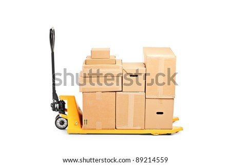A studio shot of a fork pallet truck stacker with many boxes isolated on white background