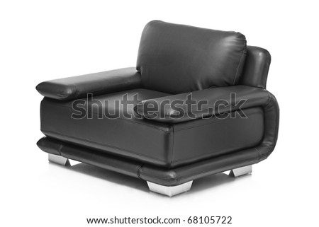 A studio shot of a leather black armchair isolated on white background