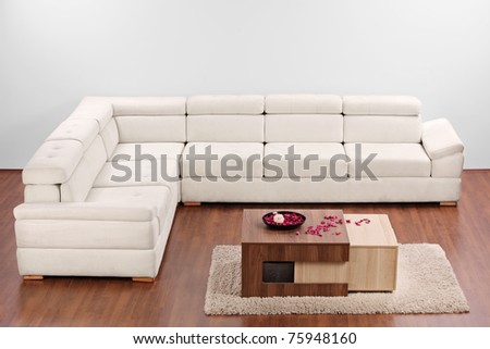 A studio shot of a modern minimalist living room with white furniture - stock photo