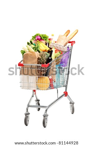 A studio shot of a shopping bag full with healthy groceries isolated on white background - stock photo