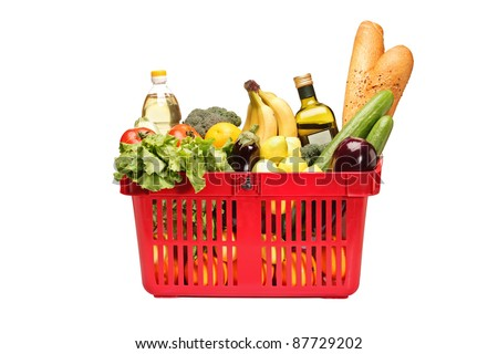 A studio shot of a shopping basket full with groceries isolated on white background - stock photo