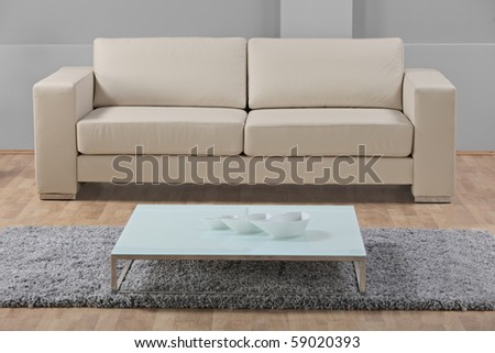 A studio shot of a white leather furniture - stock photo