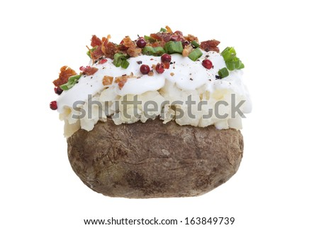 A stuffed baked potato with sour cream, bacon bits, and Green onions. Shot on a white background.  - stock photo