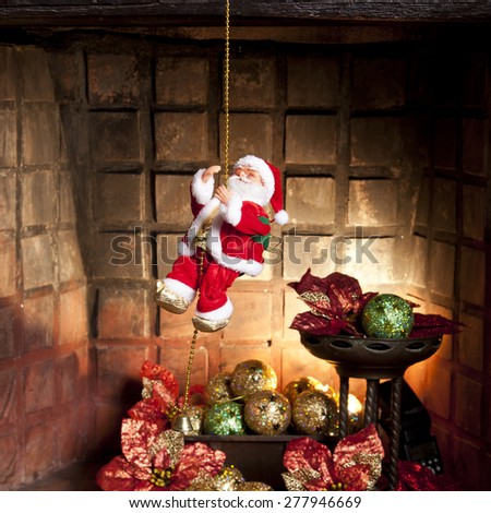 a stuffed santa claus in chimney background - stock photo