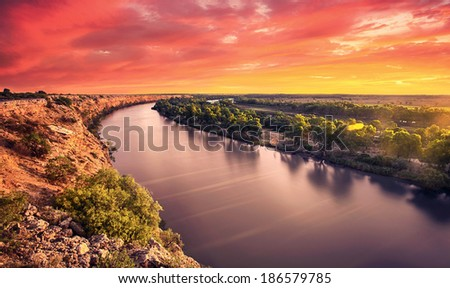 A stunning sunset on the River Murray - stock photo