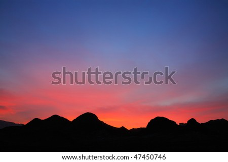 A Stunningly Brilliant Sunrise Near Lake Mead At The Border Between Nevada And Arizona - stock photo