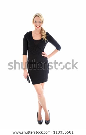 A stylish young blonde woman in black dress in little black dress with black accessories - stock photo
