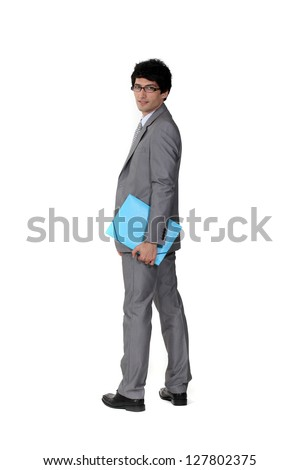 A suave businessman holding a file - stock photo
