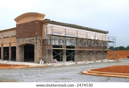 A suburban shopping center in Atlanta in the middle stages of construction. - stock photo