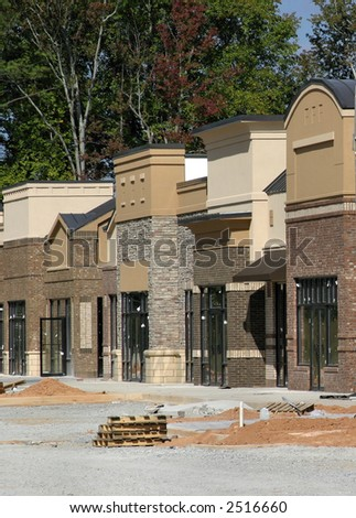 A suburban shopping center in Atlanta under construction, designed to look like a small town main street. - stock photo