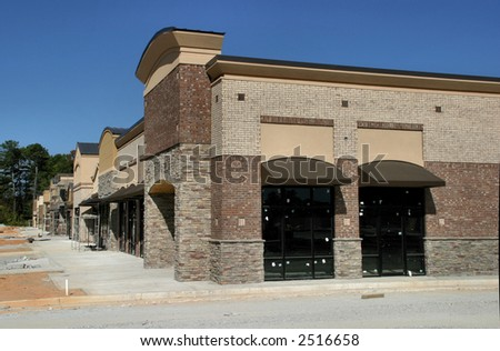 A suburban shopping center in Atlanta under construction.  Side view - stock photo