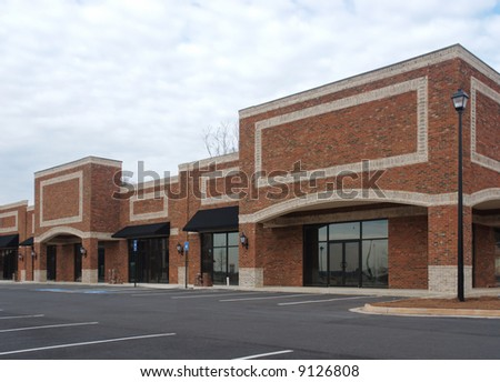 A suburban shopping center in the final stages of construction. - stock photo