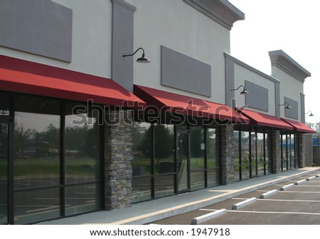 A suburban shopping center under construction - stock photo