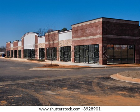 A suburban shopping center under construction. - stock photo