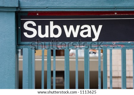 A subway sign at a sidewalk entrance, in New York City. - stock photo