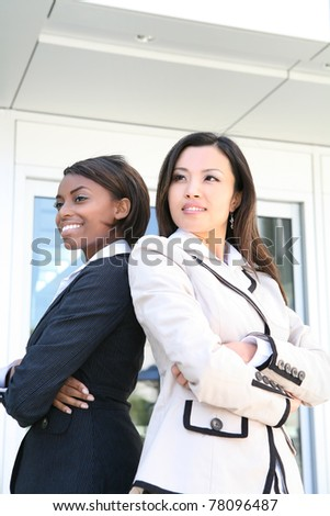 A successful asian and african business team of diverse women - stock photo