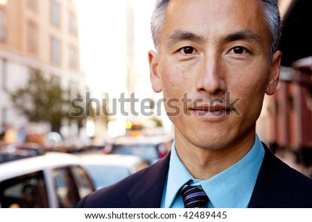 A successful business man in a street setting - stock photo