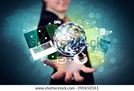 A successful businessman has control over the world concept holding planet earth, laptop in his hand with graph curves in the background. Elements of this image furnished by NASA. - stock photo