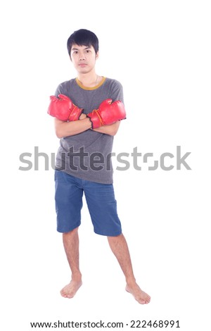 A successful businessman holding boxing gloves up symbolizing conflict  - stock photo