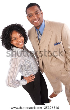 a successful couple poses for the camera