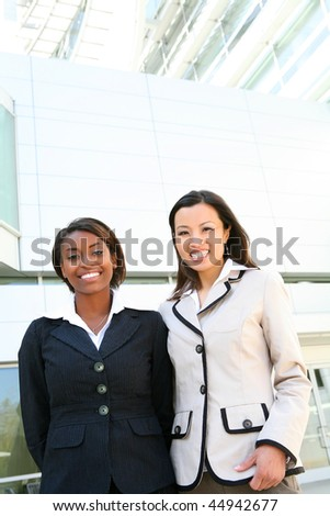 A successful, diverse business women  team at office building - stock photo