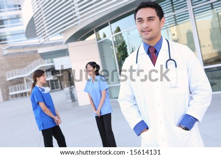 A successful, diverse man and woman  medical team outside hospital - stock photo