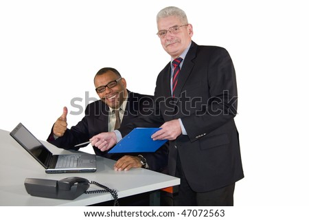 a successful interracial business team with a mature African-American and a caucasian senior businessman, isolated on white background - stock photo