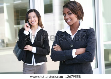A successful, pretty, business team of diverse women - stock photo