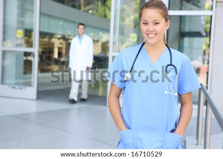 A successful pretty woman nurse outside hospital office building - stock photo