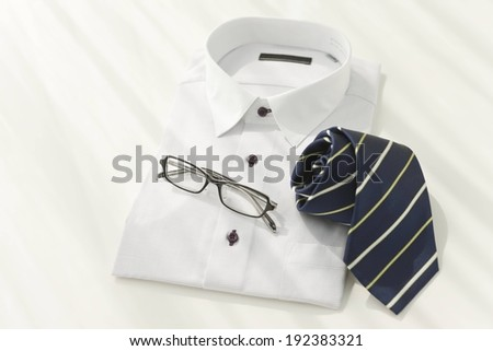 A suit and a tie with black spectacles. - stock photo