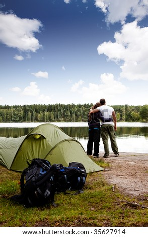 A summer camping lifestyle shot with a forest and lake landscape