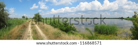 a summer Dnieper backwater panoramic view in Southern Ukraine - stock photo