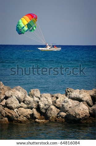 A summer sport - parasailing and boat - stock photo