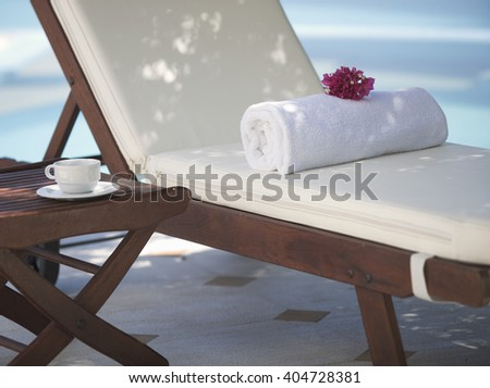 A sun lounger by a pool - stock photo