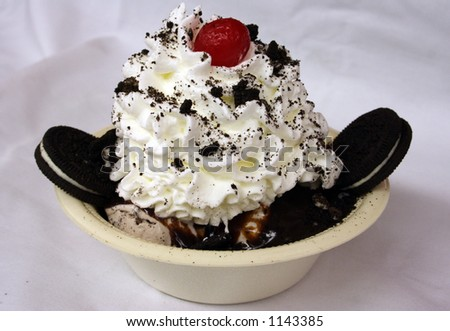 A sundae with hot fudge and Cookies n' Cream ice cream