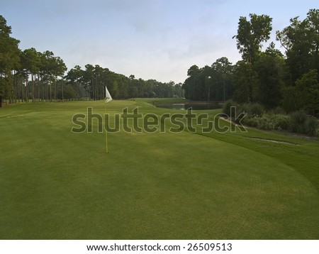 A sunny view of this beautiful golf course in Myrtle Beach, South Carolina. - stock photo