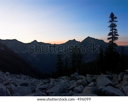 A sunrise view of Alaska Mountain and adjoining ridgeline as seen from the Pacific Crest Trail in Washington State. - stock photo