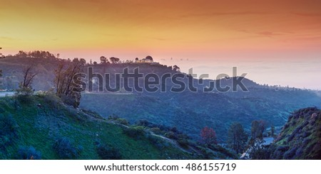 A Sunrise View of the Griffith Observatory and Downtown Los Angeles - Hollywood Hills California