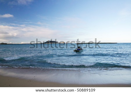 A sunset beach view in Hawaii. - stock photo