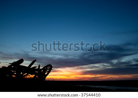 A sunset on a Saskatchewan prairie landscape - stock photo