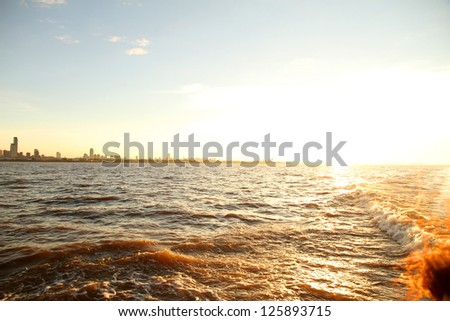 A sunset over the Rio de la Plata with the City of Buenos Aires in the background. - stock photo