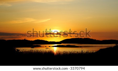 A sunset over water. The archipelago of western Sweden. - stock photo
