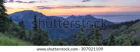 A sunset panorama looking North From Hurricane Ridge over Hurricane Hill, Unicorn Peak and Mt., Angeles toward the foggy Strait of Juan de Fuca in Olympic National Park, WA - stock photo